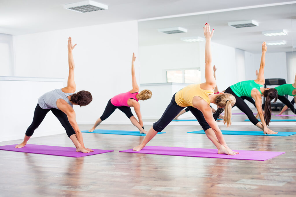yoga class reverse triangle position